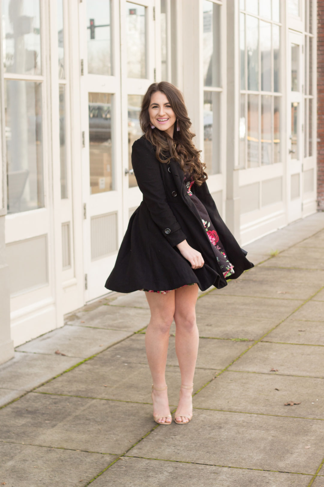 Twirling this Winter in a black skirted pea coat, floral dress, and glittery tassel earrings.