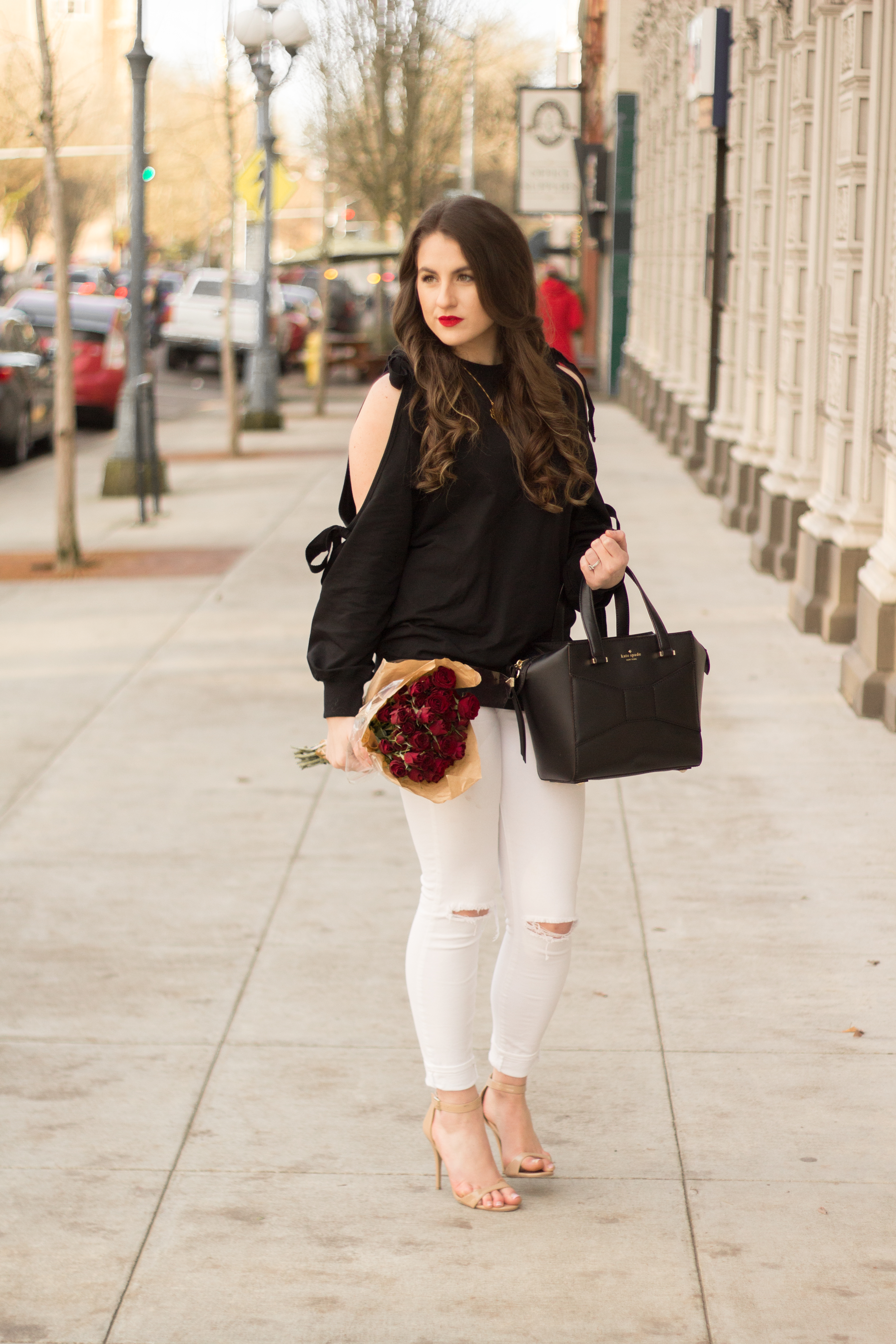 The perfect subtle Valentine's Day look with bows on your sleeves and red roses.