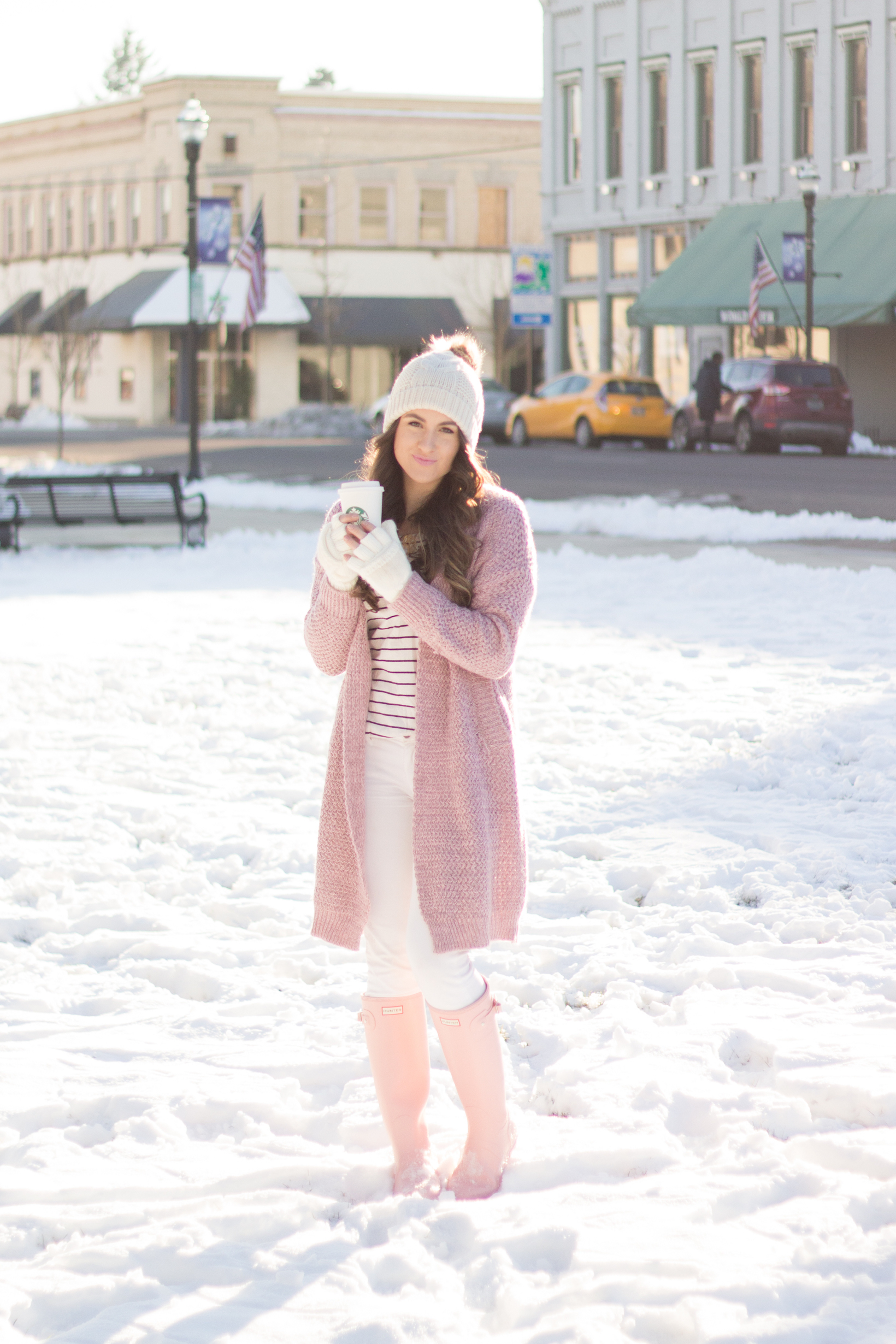 A fun pink knit sweater and pink hunter boots are the perfect equation for a snow bunny look.