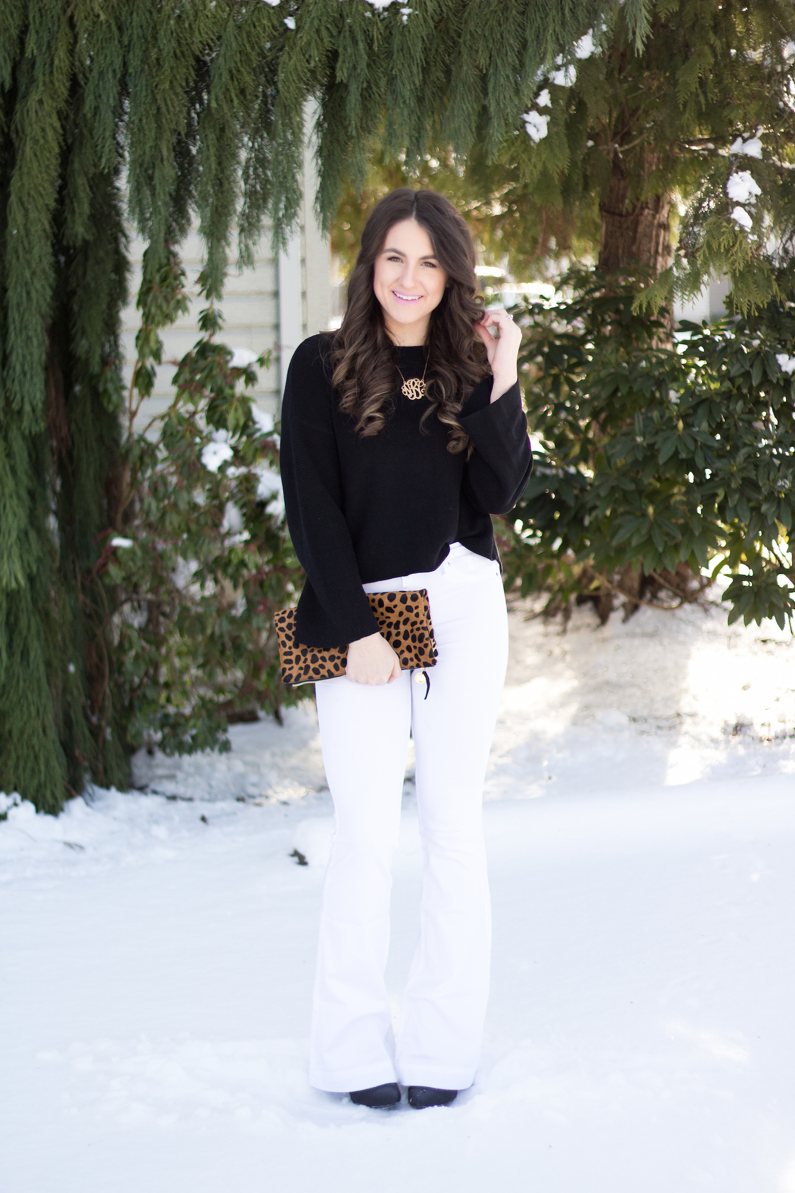 Winter white flares with black flared sleeve sweater for styling flares with confidence.
