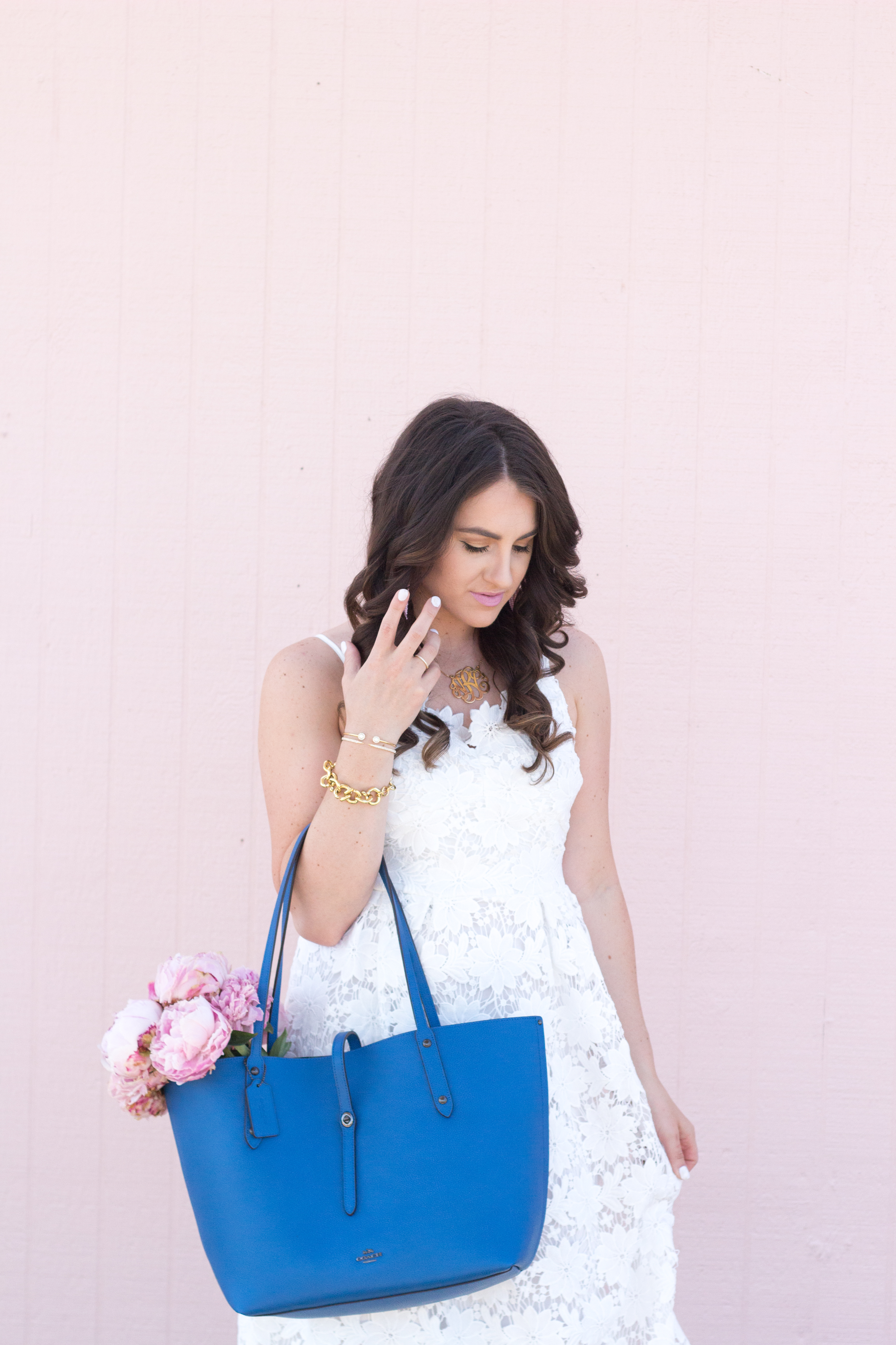 Classic style for Summer in this white dress and blue coach bag for inspiration.